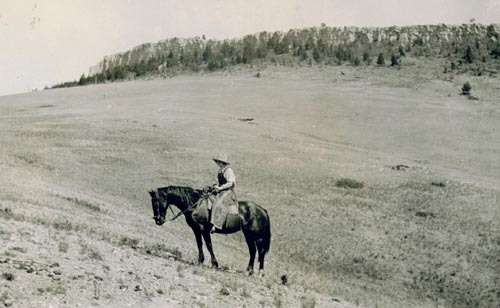 Berneta on horseback at Wall Mountain, near the Doig homestead
